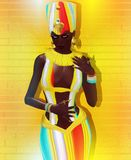 Sexy Egyptian woman, pharaoh or princess surrounded by colorful ribbons of rainbow colors. A matching outfit creates a brilliant and fun realistic scene. This Royalty Free Stock Photo