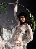 Sexy elegance girl In a lacy peignoir, swinging on a metal swing. holds on metal rods Royalty Free Stock Image