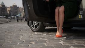 Sexy elegant female legs stepping out of car stock footage