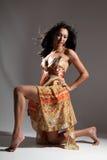elegant model with long legs kneeling Stock Photography