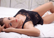 Sexy elegant woman lying on the bed Stock Photography