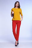 Sexy elegant woman natural beauty fashion style clothes casual. Formal suit lady in red silk romantic meeting date blouse and pants party style glamour model Stock Photography