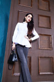 Sexy elegant woman natural beauty fashion style clothes casual. Formal suit white cotton blouse silk pants romantic date blouse and pants party style glamour Royalty Free Stock Photography