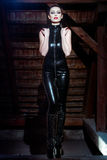 Sexy emotional dominatrix posing in catsuit Royalty Free Stock Image