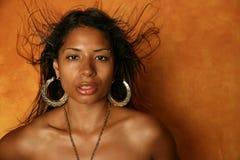 Sexy ethnic girl. Beautiful long-haired ethnic woman headshot Stock Image