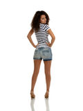 Ethnic Lady. A portrait of brunette posing in jeans shorts and marine top stock image
