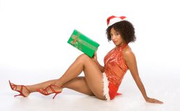 Sexy ethnic woman in hat with Christmas gift Royalty Free Stock Photo