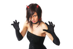 Sexy evil:). Portrait of bad girl on white with red horns and earrings Royalty Free Stock Images