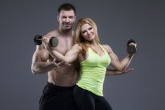 Sexy exerciser couple Stock Photography
