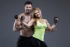 Sexy exerciser couple Stock Photography