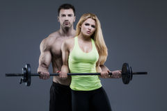 Sexy exerciser couple Stock Images