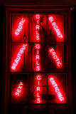 Sexy Exotic Enticing Erotic Girls Red Neon Sign Royalty Free Stock Image