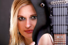 Sexy face girl and Guitar Woman Royalty Free Stock Image