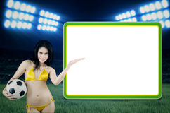Sexy fans presenting copyspace at stadion Royalty Free Stock Photo