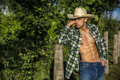 farmer or cowboy with unbuttoned shirt Royalty Free Stock Photo