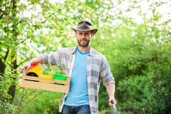Sexy farmer hold wooden box with pot. farming and agriculture cultivation. Garden equipment. Eco farm worker. Harvest. Happy earth day. Eco living. ranch man stock photography