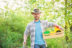 Sexy farmer hold wooden box with pot. farming and agriculture cultivation. Garden equipment. Eco farm worker. Harvest royalty free stock photography