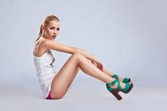 Sexy fashion beauty woman siting - long heels Royalty Free Stock Photo