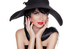 Sexy Fashion Brunette Woman Portrait in black hat isolated on Wh Royalty Free Stock Images