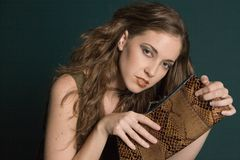 Fashion girl. Female model posing with purse stock photos