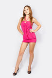 Sexy fashion girl. Harmonous girl model in a pink dress Royalty Free Stock Images