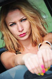 Sexy fashion girl sitting in a car Royalty Free Stock Photo