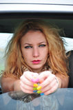 Sexy fashion girl sitting in a car Royalty Free Stock Photos