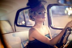 fashion girl sitting in old car Stock Photo