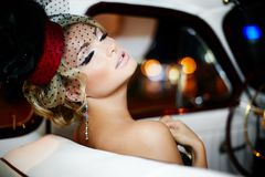 Sexy fashion girl sitting in old car Stock Image