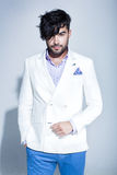 Sexy fashion male model dressed elegant - casual posing against wall Royalty Free Stock Images
