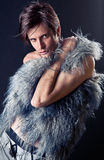 Sexy fashion man. Young, sexy man, with keen eyes, in furs Royalty Free Stock Photo