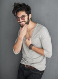 Sexy fashion man with beard dressed casual smiling. Against wall Royalty Free Stock Photo