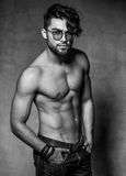 Sexy fashion man with glasses top naked posing dramatic against grunge Royalty Free Stock Photography