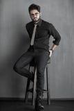 Fashion man model dressed casual posing dramatic in the stu. Dio stock photo