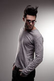 Sexy fashion man model dressed casual posing dramatic in the studio Stock Photo