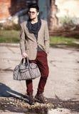 Sexy fashion man model dressed elegant holding a bag Royalty Free Stock Image