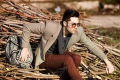fashion man model dressed elegant holding a bag Stock Images