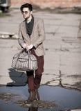 fashion man model dressed vintage elegant holding a bag posing outdoor royalty free stock photos