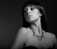 Sexy fashion model in necklace on dark Royalty Free Stock Photography