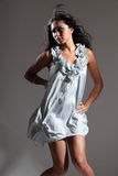 fashion model poses in short dress Royalty Free Stock Photo