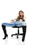 Sexy fashion model sitting on chair Stock Photography