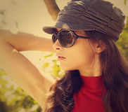 Sexy fashion model in sun glasses and cap Royalty Free Stock Photos