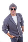 Sexy fashion model in sweater wearing winter cap and sunglasses Royalty Free Stock Images