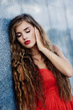 Sexy fashion portrait. Beautiful model with red sexy lips and long hair staying closing eyes Royalty Free Stock Images