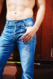 Sexy fashion portrait hot male model in stylish jeans with muscular body posing Royalty Free Stock Photography
