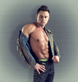 Sexy fashion portrait of male model in stylish clothes with muscular body. Royalty Free Stock Photo