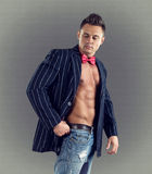 Sexy fashion portrait of male model in stylish clothes with muscular body. Stock Images