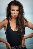 Sexy fashion portrait of young beautiful woman in black swinsuit Royalty Free Stock Images