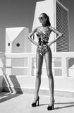 Sexy fashion woman with long legs in a swimsuit, in shoes. Fashion girl Royalty Free Stock Photo