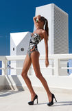 Sexy fashion woman with long legs in swimsuit, in shoes, outdoor Royalty Free Stock Image
